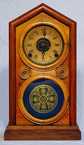 KIRTLAND H. CRUMP - rosewood and mahogany doric mantel clock - Horloge À Poser