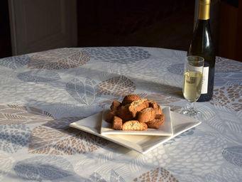 FLEUR DE SOLEIL - nappe enduite feuilles gris beige 160x160 - Nappe Enduite