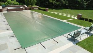 Pool cover with eyelets