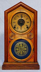 KIRTLAND H. CRUMP - rosewood and mahogany doric mantel clock - Desk Clock
