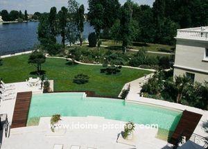 Idoine Piscines - a débordement - Traditioneller Swimmingpool