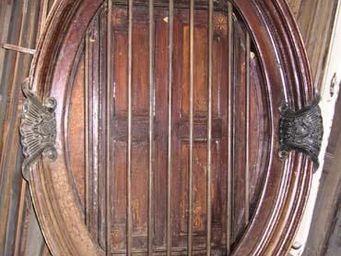 La Farfouille - paire d'oeil de boeuf avec volets époque colonial - Rundfenster